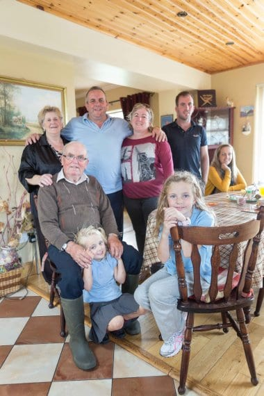 27/09/2013 Wild Irish Sea Veg, Caherrush, Spanish Point, Co Clare, Ireland. The Talty Family (clockwise from front left seated) Kayla Darcy and her Great Grandfather and Grandmother Michael and Mary Talty, Gerard and Eileen Talty, Evan Talty and Allisha Talty, and Ellie Talty having dinner at home in Caherrush, Co Clare, Ireland. Photograph by Eamon Ward